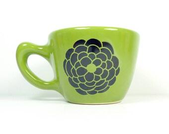 a 12oz cup glazed in Avocado Green with Dahlia flower prints READY TO SHIP