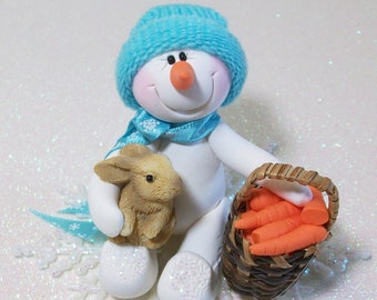 Snowman ornament: Sharing his carrot noses with bunny friend