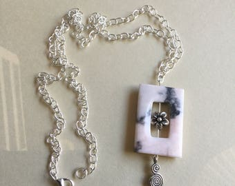 Trendy light pink rhodonite pendant with silver charms