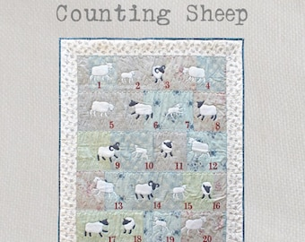 Counting Sheep - A delightful and fun appliqué quilt featuring rams, ewes and lambs frolicking in the meadow!