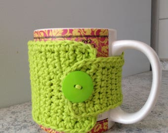 Lime green crochet cup cozy with a button, crochet mug cozy