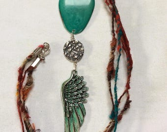 Vertigris wing pendant fine silver necklace.Turquoise green tagua nut pendant.Recycled sari silk necklace.