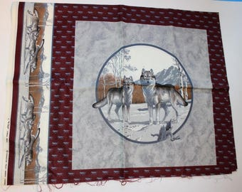 Piece of cotton fabric that feature a pack of wolves and a bear