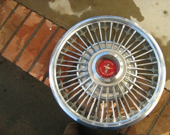Vintage ford mustang wire rim hub cap