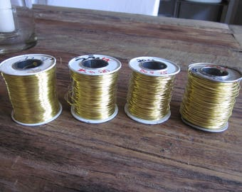 Four spools of brass wire 28- 22- 20- 18 gauge