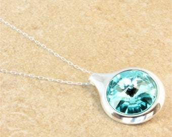 Swarovski Silver Circle Pendant Necklace with Light Turquoise Crystal Rivoli on Silver Plated Chain