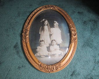 Antique Edwardian Ornate Oval Wood and Gesso Bubble Glass Frame with Portait of Adorable Children