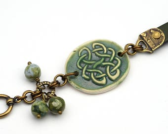 Green Celtic bracelet, ceramic leather mixed metal copper brass rhyolite, 7 3/4 inches long