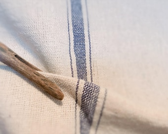 Reproduction Grain Sack Fabric Sold By The Yard. Thick Blue Stripe on Cream.