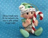 Personalized ornament baby boy girl holding candy cane green clothes gift box included