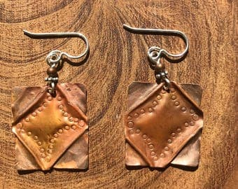 Repurposed roofing copper fold formed earrings.