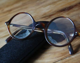 Vintage brown tortoiseshell style round glasses with bi-focal lenses in case