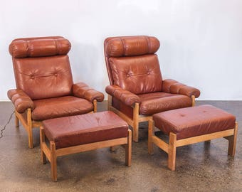 Pair of Scandinavian Modern Tufted Chestnut Lounge Chairs with Footstools