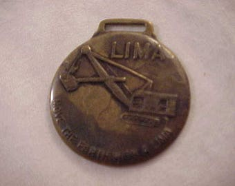 Lima Heavy Equipment Brass Advertising Watch Fob