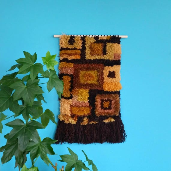 Woven wall hanging. Brown and mustard yarn with a retro 1970s vibe.
