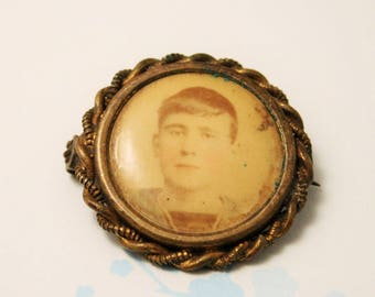 Victorian locket brooch. Brass photograph brooch