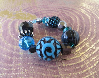 Stretchy Chunky Beaded Bracelet In Blue Black And Silver Tones
