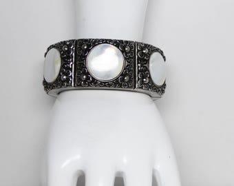 Vintage Kramer Expansion Bracelet - Silver ToneRepousse Flowers & Mother of Pearl Circle Disk - Vintage 1960's