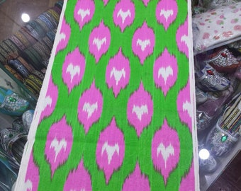 Uzbek traditional handwoven green silk ikat fabric by meter. Tribal, ethnic, boho fabric