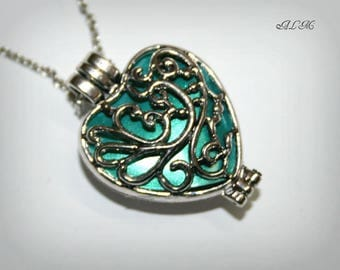 Heart pendant for a turquoise background (v) photo