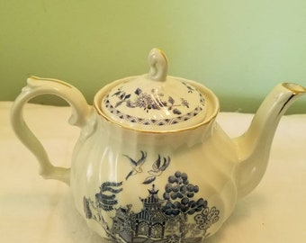 Blue willow teapot by Robinyon Design Group