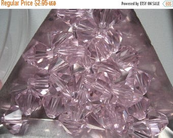CLEARANCE Blush Crystal Bicones 10mm QTY - 8