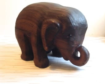 Vintage 1970 Wood Elephant Sculpture. Modernist carved cryptomeria wood figure. Glass eyes.  Made in the California Redwoods.