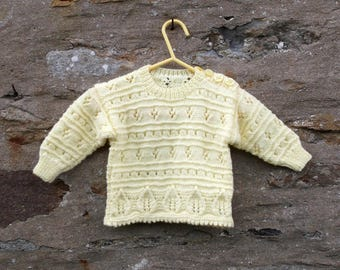 "Hand knitted baby girl's yellow tunic style pullover sweater and bonnet. 18"" chest. 3 to 6 months approx"