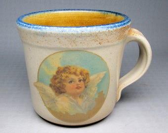 MONROE SALT WORKS mug with a cherub / angel , salt glazed stoneware / pottery