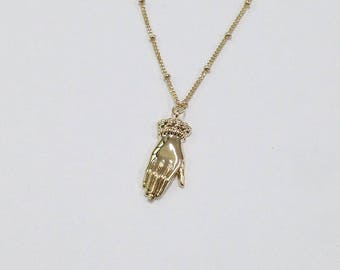 hand with victorian sleeve charm chain necklace charm necklace unique
