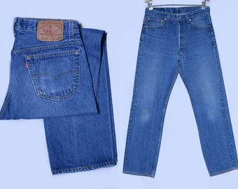 Vintage Levis 501 Distressed Button Fly Made in USA Blue Denim Jeans 32 x 31