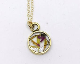 Strawflower petals in gold pendant on chain