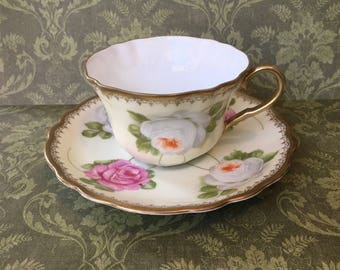 Gorgeous Bavarian Hand Painted Teacup and Saucer with Roses in Peach and Pink