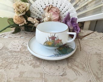 Lovely Hand Painted Porcelain Teacup and Saucer with Surprise Geisha Lithophane