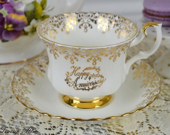Royal Albert Happy Anniversary Teacup and Saucer, English Bone China Gold And White Tea Cup, ca. 1950-1970