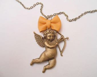 Necklace Cupid with a mustard yellow leather bow