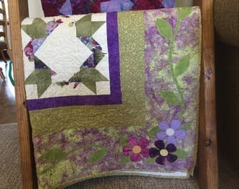 Queen bed quilt in purple, green, cream and blue
