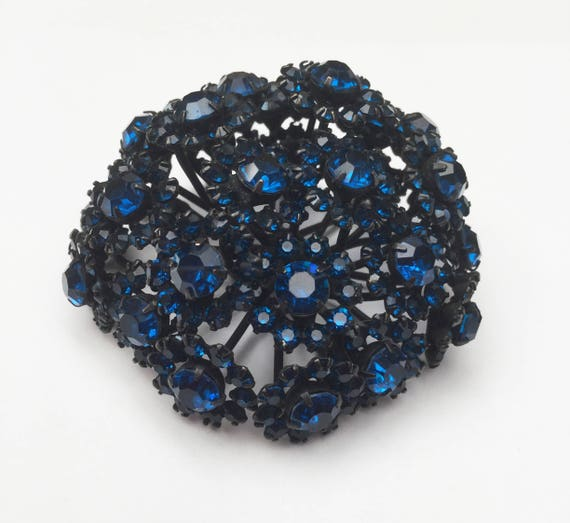 Blue  Rhinestone  Brooch -Signed Warner  - High domed  - colbalt blue  - Black japanned - floral flower - vintage pin