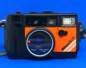 Nikon L35AWAF (Action•Touch) *Underwater/Waterproof* Orange, f/2.8 35mm Lens, Autofocus Point and Shoot 35mm Film Camera