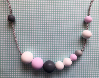 Teethin necklace in grey, white and light pink silicone beads