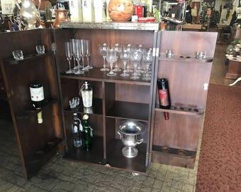 Fold away bar cabinet