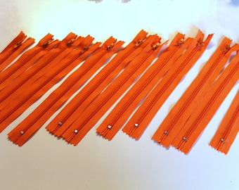Orange set of 12 zippers 20cm