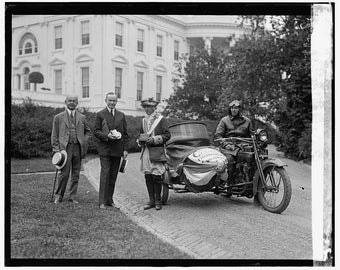 President Coolidge, sidecar motorcycle, in front of White House, 1924