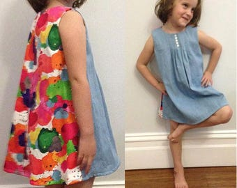 Girls chambray denim and rainbow paint splat cotton sateen dress with embroidered flower detail and stud closure