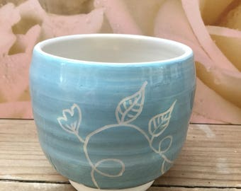Hand decorated blue tea bowl with trailing leaf pattern