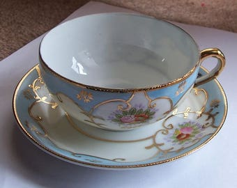 Beautiful Porcelain Occupied Japan Cup and Saucer in Blue Decorated With Moriage and Signed