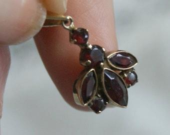 Gold and Garnet Pendant, 7 Garnet Stones