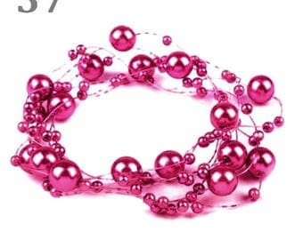 Wreath decorated with beads Fuchsia 130 cm