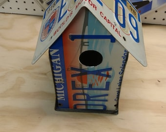 A birdhouse built from Michigan license plates, MI