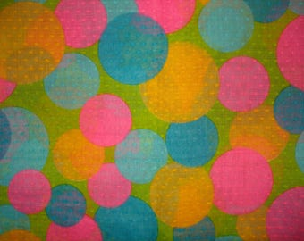Lightweight Dotted Swiss Fabric Bright colored circles, bubbles, balloons 1 yard & 30 inches Blue Yellow Pink on Green background